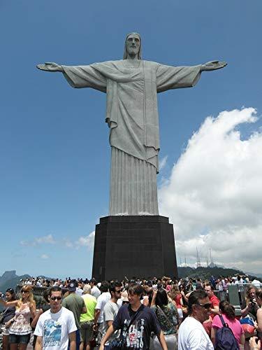 Toeristen maken dankzij een geheugenkaart vakantiefoto's van het Christusbeeld